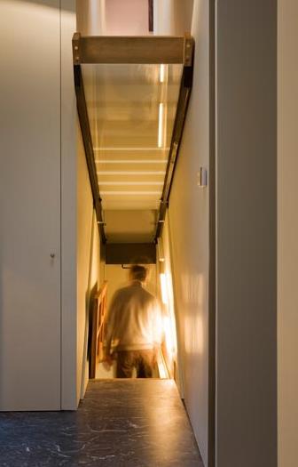 Passageway hidden underneath fold up stairs StashVault