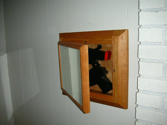 Mirror swings out to reveal hidden storage stashvault for How to make a secret compartment in your wall